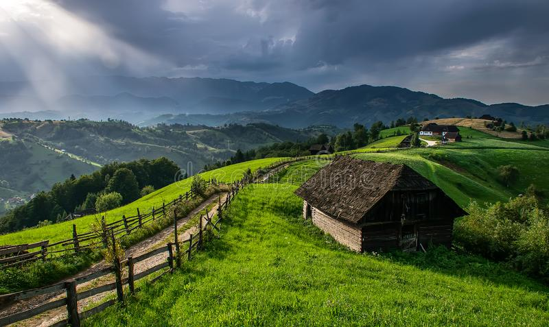 Romanian hillside and village in summer time , mountain landscape of Transylvania in Romania royalty free stock images