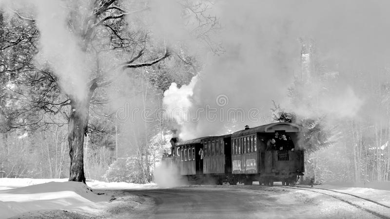 Romanian Bucovina landscape with old steam train in the winter time stock image