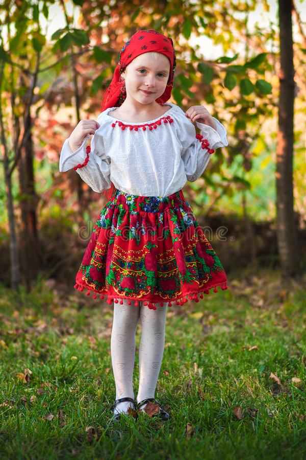Romanian girl with traditional costume. Romanian little girl wearing traditional costume from Maramures royalty free stock images