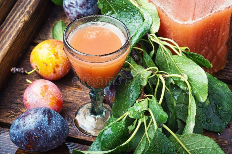 Romanian national plum liquor. Slivovitsa-plum brandy.Slivyanka,strong alcoholic drink made from ripe plums stock images