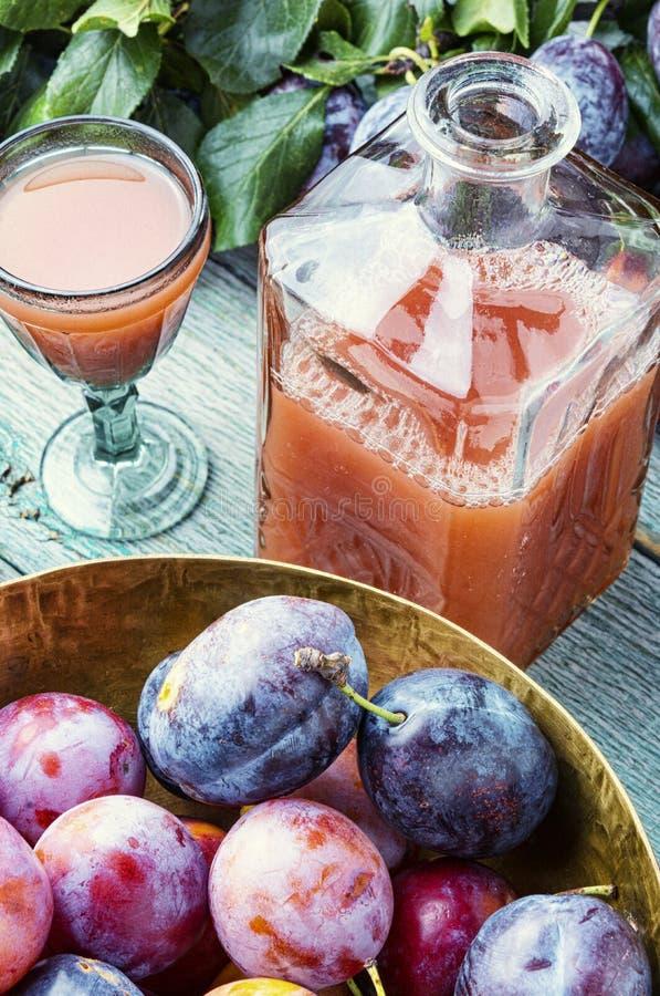 Romanian national plum liquor. Slivovitsa-plum brandy.Slivyanka,strong alcoholic drink made from ripe plums royalty free stock images