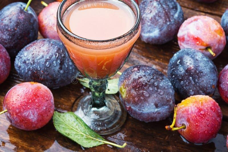 Romanian national plum liquor. Slivovitsa-plum brandy.Slivyanka,strong alcoholic drink made from ripe plums stock photos