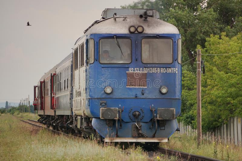 Romanian CFR Old Commuter Train With A Blue Locomotive