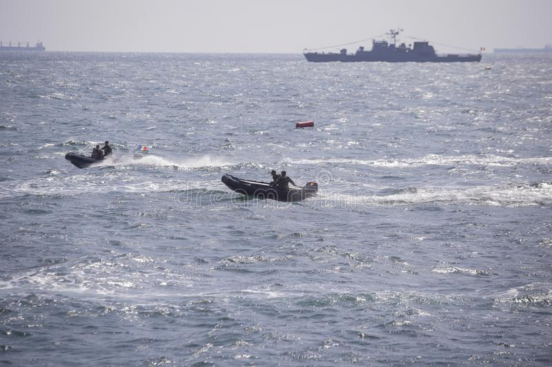 Romanian navy soldiers sail with a rubber boat royalty free stock photos