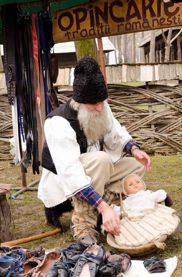 Romanian old man wearing in traditional costume stock photography