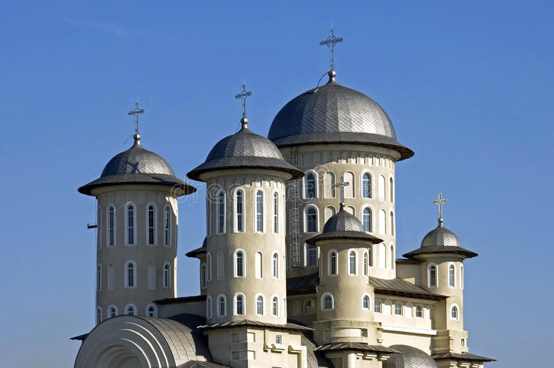 Romanian Orthodox Church, city Bacau, Romania. Romania: newly built Resurrection Church with many towers and domes. In all these domes are mounted crosses on the stock photos