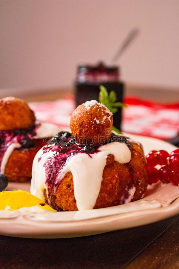 Cheese donuts with sour cream and jam stock photography