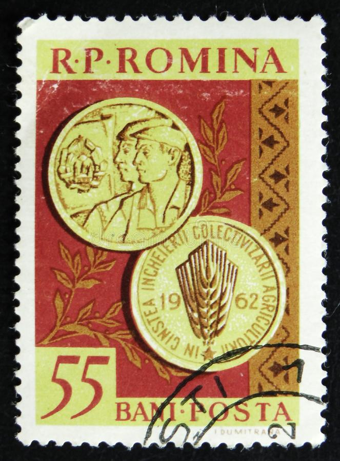 Romanian postage stamp shows medals, Completion of Agricultural Collectivisation Project, circa 1962. MOSCOW, RUSSIA - APRIL 2, 2017: A post stamp printed in royalty free stock photo