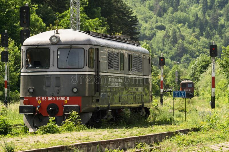 Romanian private railway operator diesel locomotives shunting. Private railway operator DB Schenker Rail and Heidelberg Cement locomotives are shunting in Bicaz royalty free stock photography
