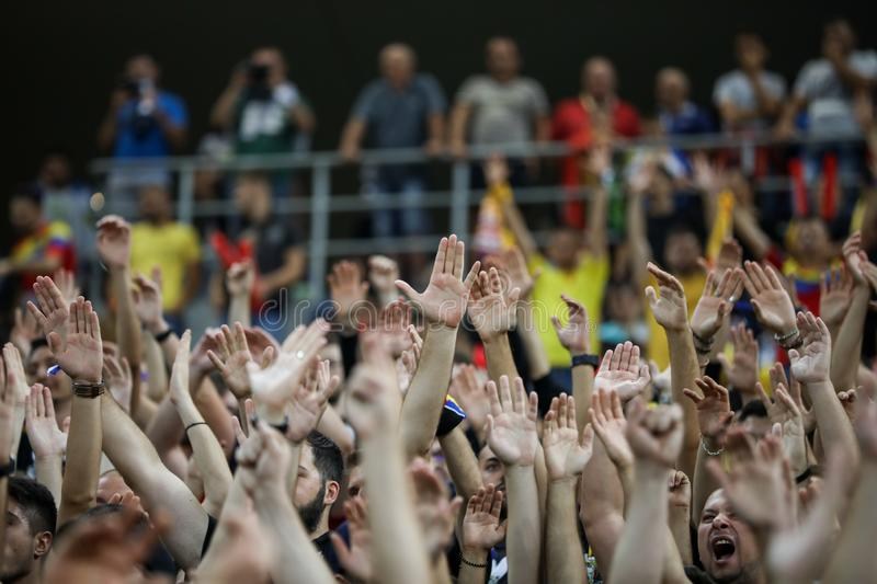 Romanian soccer fans react during the Euro 2020 Qualifier - Group F - Romania v Spain National, on National Arena Stadium Arena stock photo