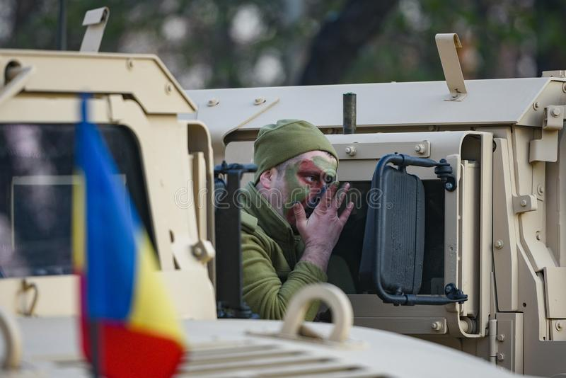 Romanian soldier. Bucharest, Romania - December 01, 2018: Romanian Army soldier preparing for the military parade marking Romania`s Great Union Day, in Bucharest stock photos