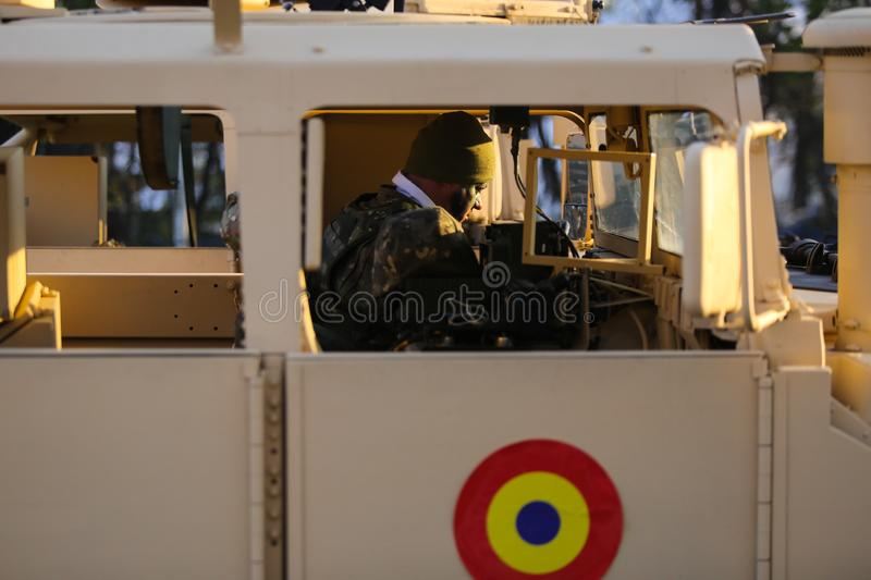 Romanian soldier in a Humvee military vehicle royalty free stock image
