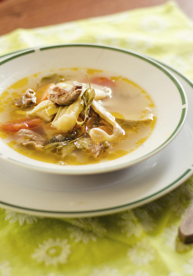 Romanian sour soup. With pork and bean pods royalty free stock photos
