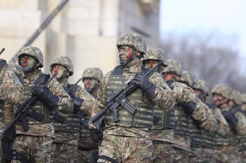 Romanian special forces soldiers, armed with M4A1 5.56×45mm NATO assault rifles. Bucharest, Romania - December 1, 2018: Romanian special forces soldiers royalty free stock photography