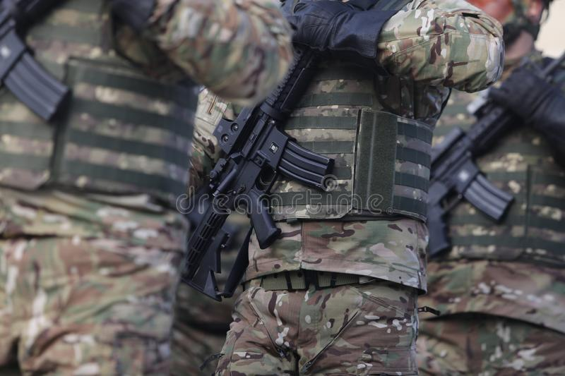 Romanian special forces soldiers, armed with M4A1 5.56×45mm NATO assault rifles. Bucharest, Romania - December 1, 2018: Romanian special forces soldiers stock images