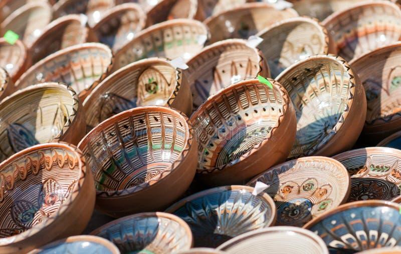 Romanian traditional ceramic plates, Romania. Romanian traditional ceramic in the plates form, painted with specific reasons. Horezu area stock photo