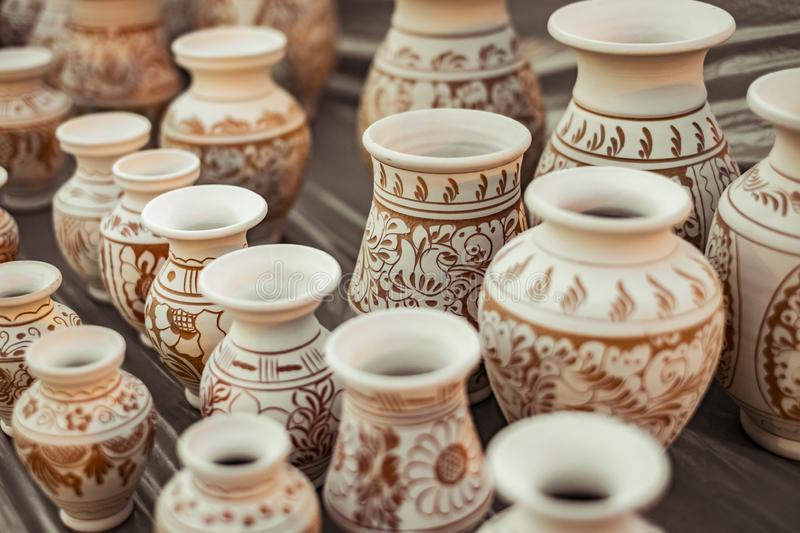 Romanian traditional ceramic vases on the pavement. Close view royalty free stock photography