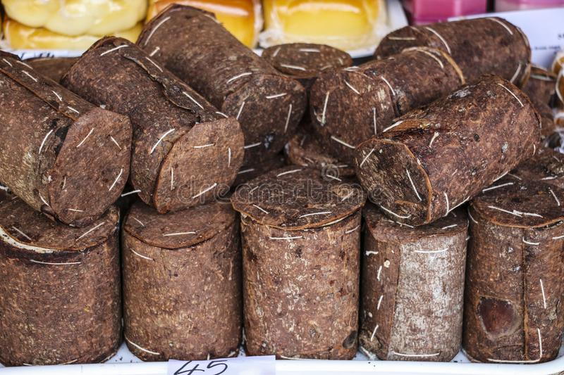 Romanian traditional cheese wrapped in fir bark and wheels of sm. Oked cheese on one of the agricultural markets region Wallachia, Romania stock photography