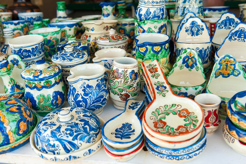 Romanian traditional pottery handcrafted mugs and plates at a souvenir shop. Romanian traditional pottery handcrafted mugs at a souvenir shop stock images