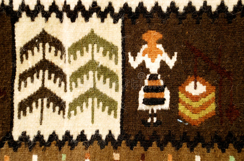 Romanian traditional rug. Woven with colored wool stock image