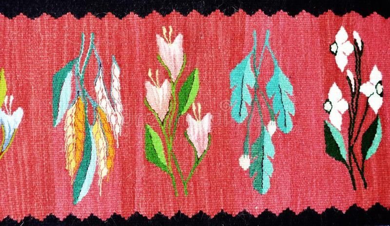 Romanian traditional rug. Romanian traditional carpet woven with colored wool royalty free stock photography
