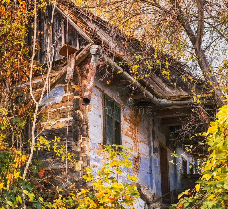 Romanian traditional wooden clay house abandoned stock photo