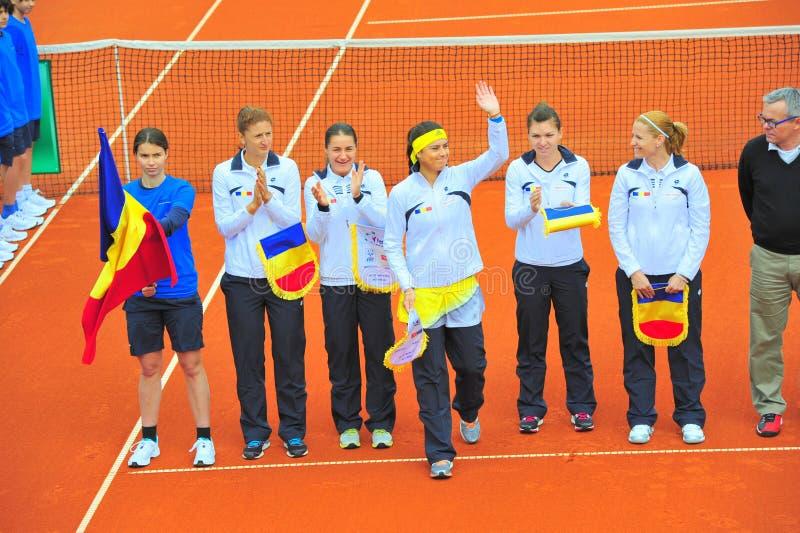 The romanian women tennis team - Sorana Cirstea saluting. The romanian women tennis team presented in the beginning of the Romania-Serbia match stock image