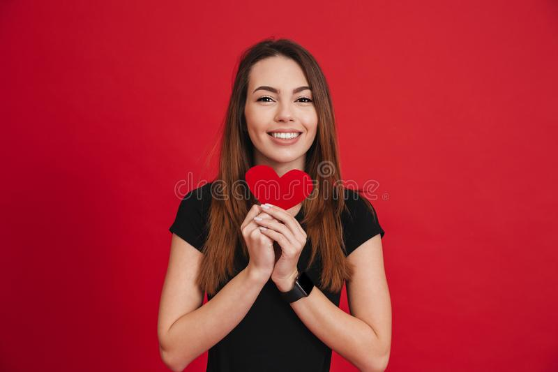 Romantic adorable woman 20s with long brown hair holding paper h royalty free stock photography