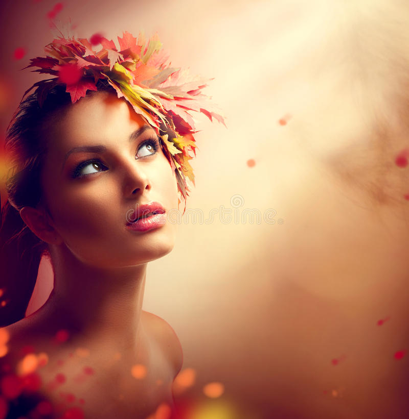 Romantic autumn girl with colorful leaves royalty free stock photography