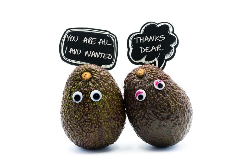 Romantic avocados couple with googly eyes royalty free stock image