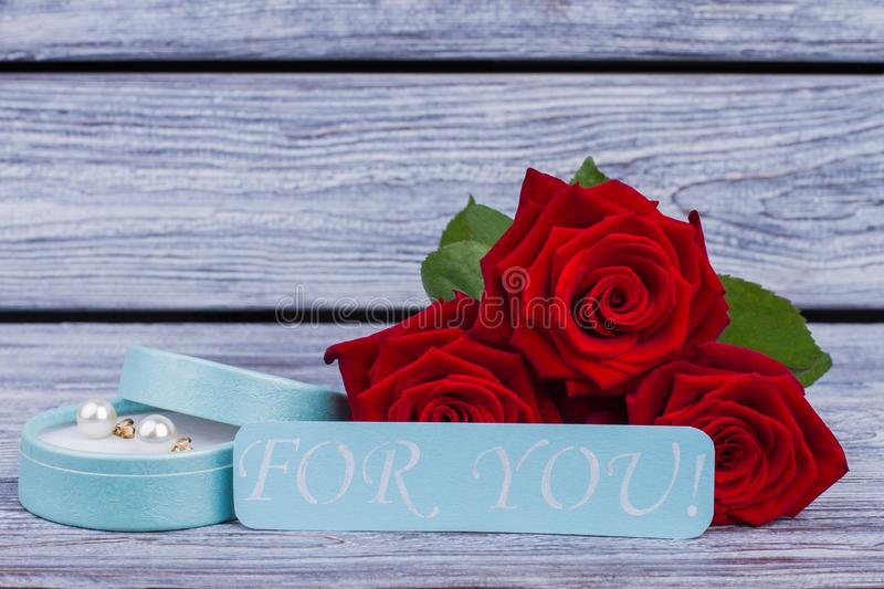 e6cde404e Romantic background with roses and jewelry box. Red rose flowers, gift box  with pearl