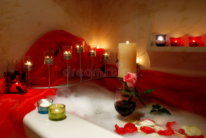 Romantic bath. Bathtub surrounded with candles, romantic atmosphere