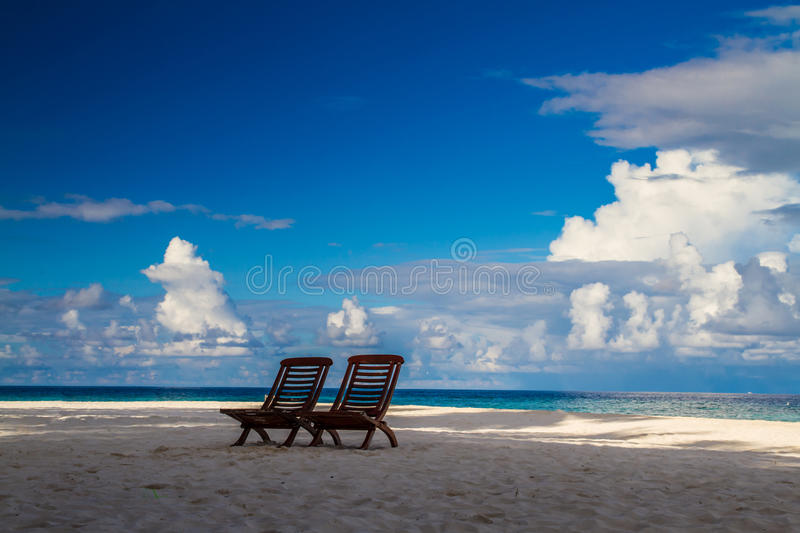 Romantic beach scenery with sunbeds on the Maldives royalty free stock photography