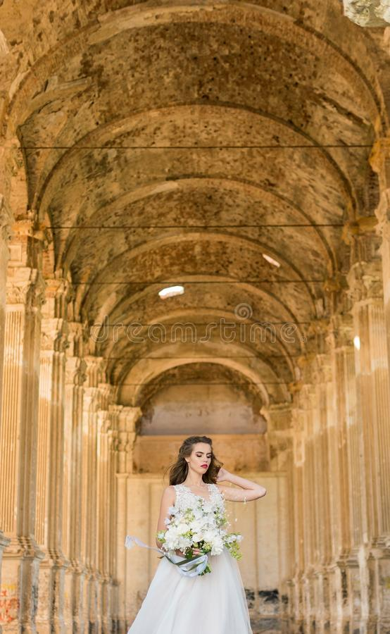 Romantic beautiful bride in luxury dress posing of beautiful architecture stock photography