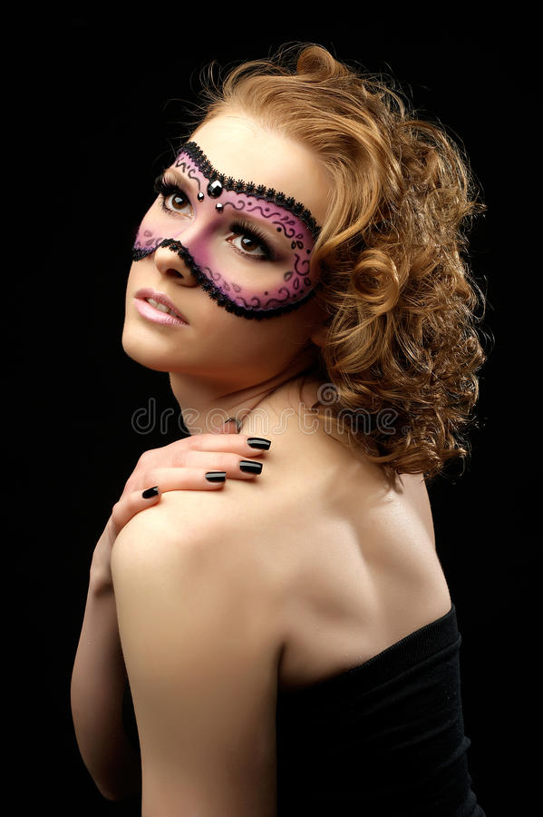 Romantic beautiful woman with a mask royalty free stock photo