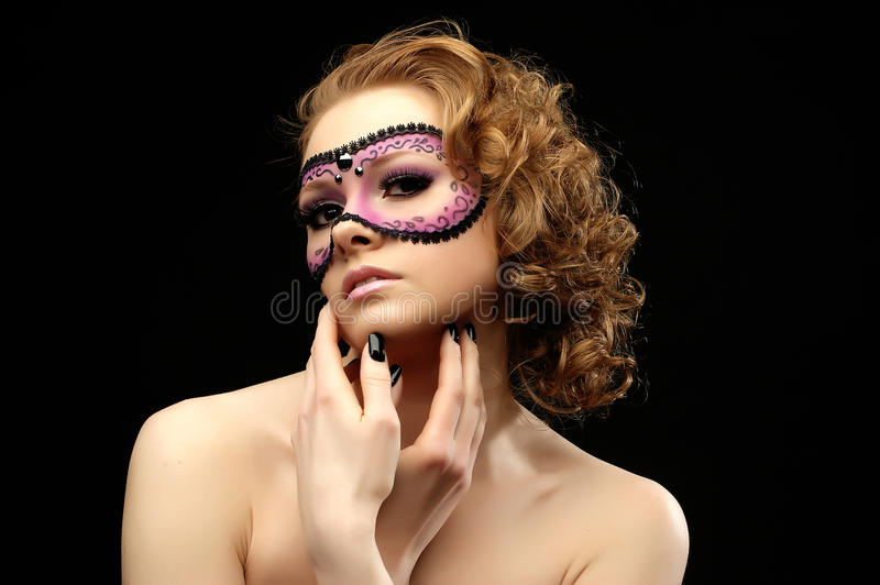 Romantic beautiful woman with a mask stock images