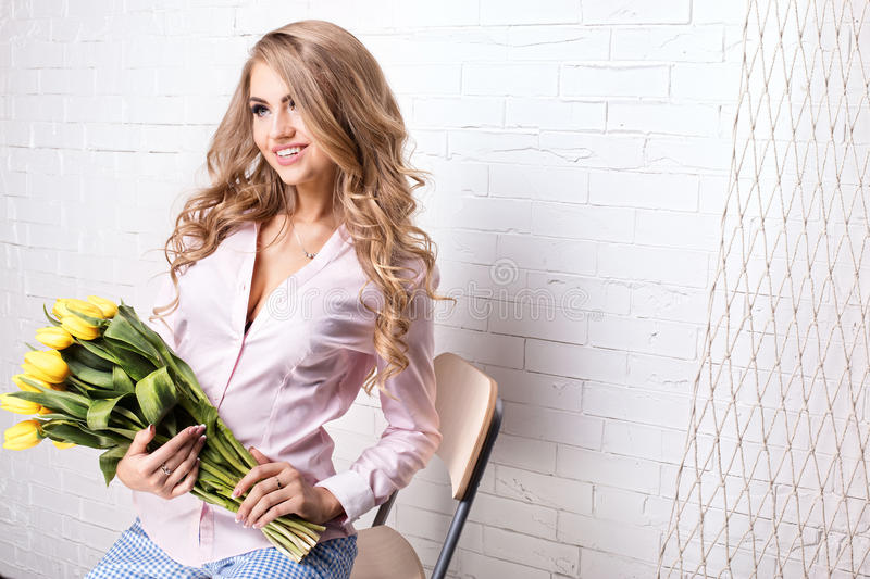 Romantic blonde lady with flowers. stock image
