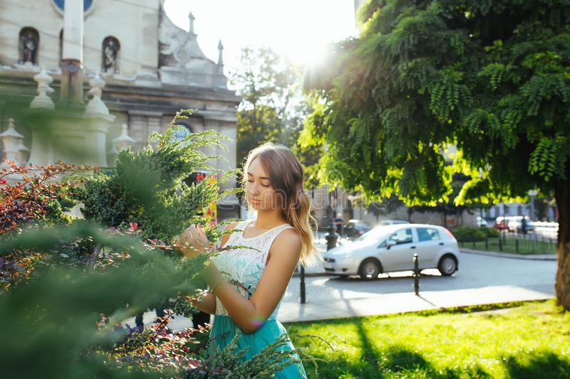 Romantic blonde woman in lace dress posing in sun rays at the pa stock images