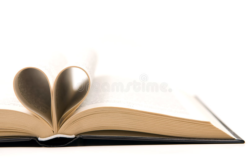 Romantic book. Book with pages curved into a heart shape stock photography