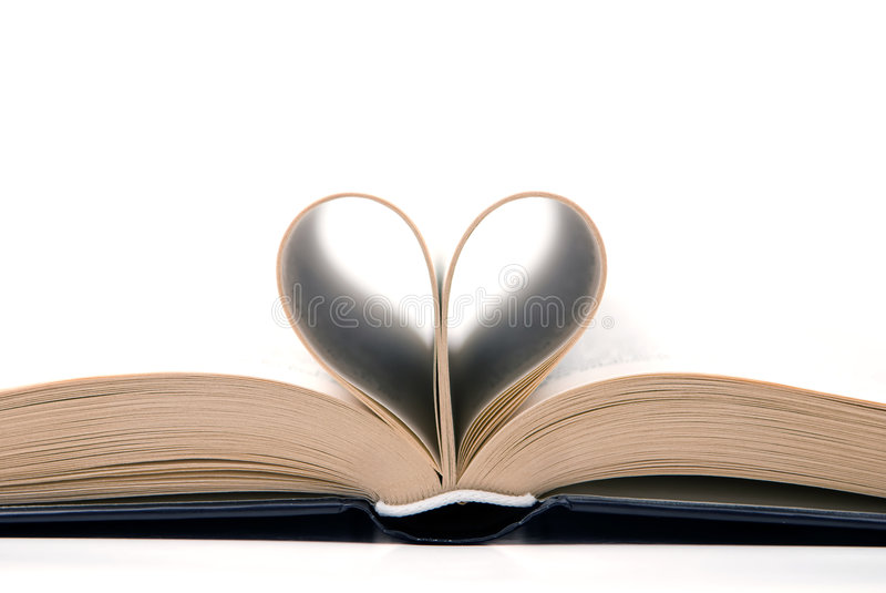 Romantic book. On the white background with pages curved into a heart shape stock photography