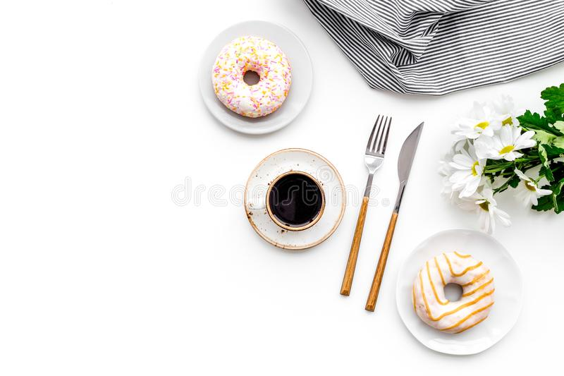 Romantic breakfast with flowers on the table. Coffee with dessert on white background top view copy space stock photos