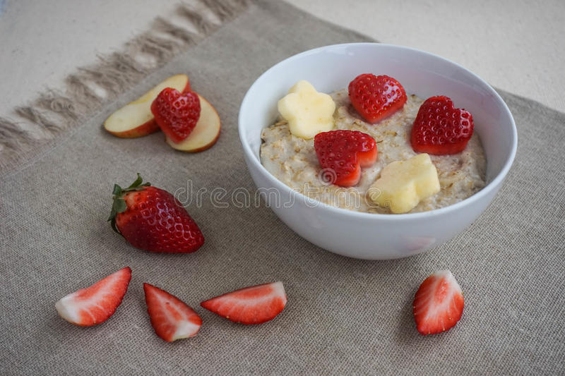Romantic breakfast with strawberries and apples royalty free stock images