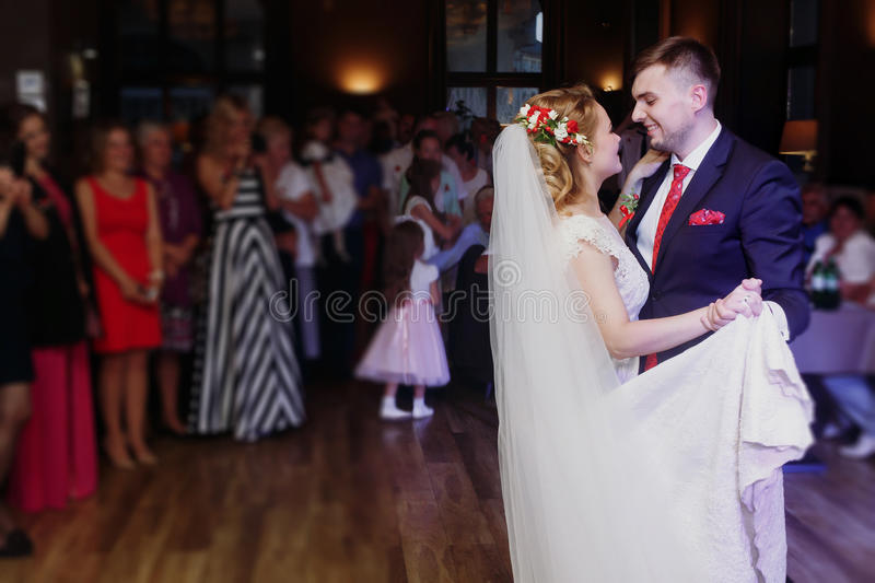 Romantic bride and groom dancing and holding hands at wedding re stock image