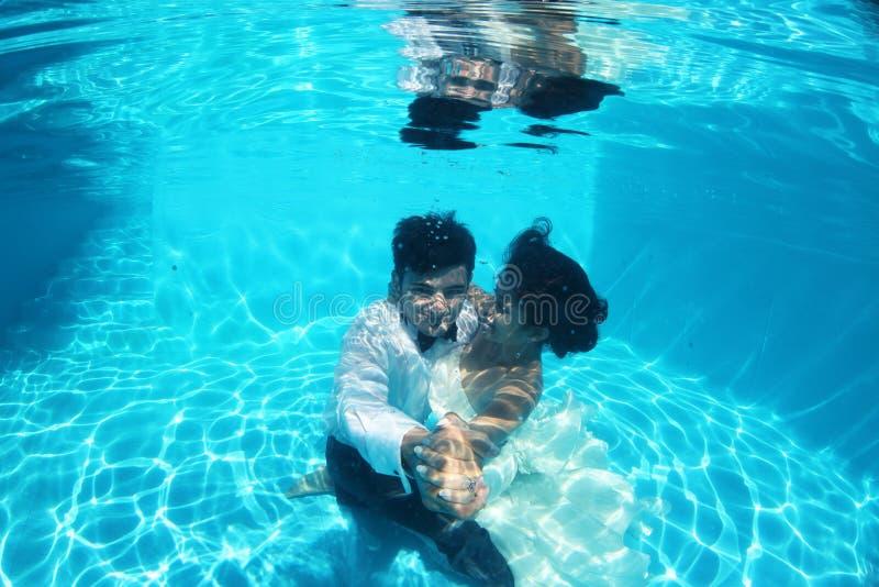 Romantic Bride And Groom Underwater Stock Photo