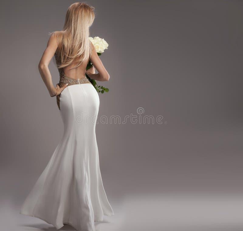Romantic bride in wedding dress. stock image