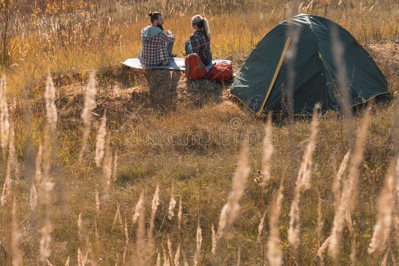 Romantic camping couple tent meadow fall nature stock image