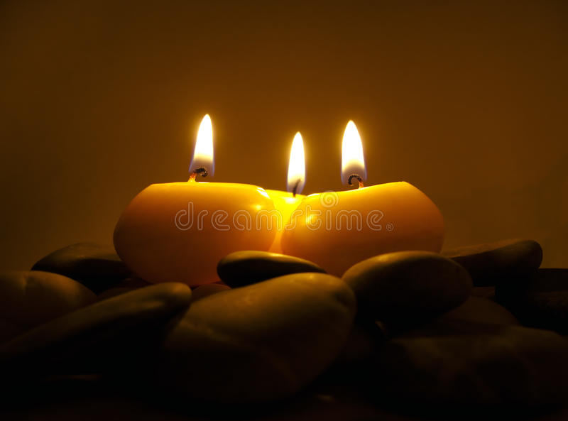 Romantic Candles On Sea Stones Royalty Free Stock Photography