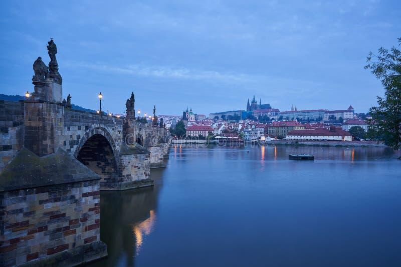 Romantic Charles bridge with Prague castle on other bank of Vltava river in Prague stock image