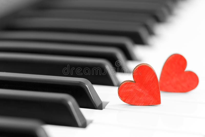 Romantic concept with piano and hearts royalty free stock image