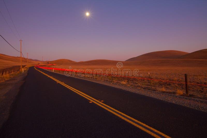 Romantic Country Road At Dusk Royalty Free Stock Photos